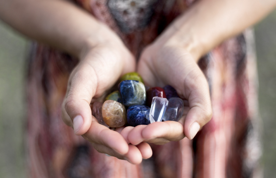 photo: woman is holding gemstones